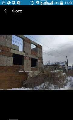 Продам земельный участок с недостроенным домом