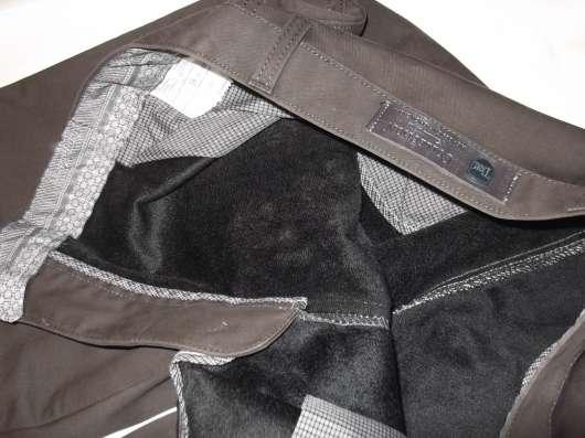 Продам джинсы утепленные коричневые р-р 52, новые в Новосибирске Фото 1
