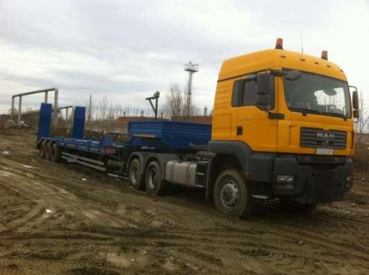наличии высокорамный трал тяжеловоз повышенной проходимости 3 осный двухсткатный грузоподъемность 60 тн подвеска BPW (Германия) в Екатеринбурге Фото 1